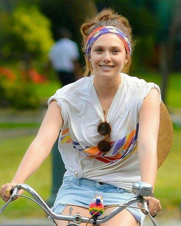 Elizabeth Olsen Riding A Bicycle