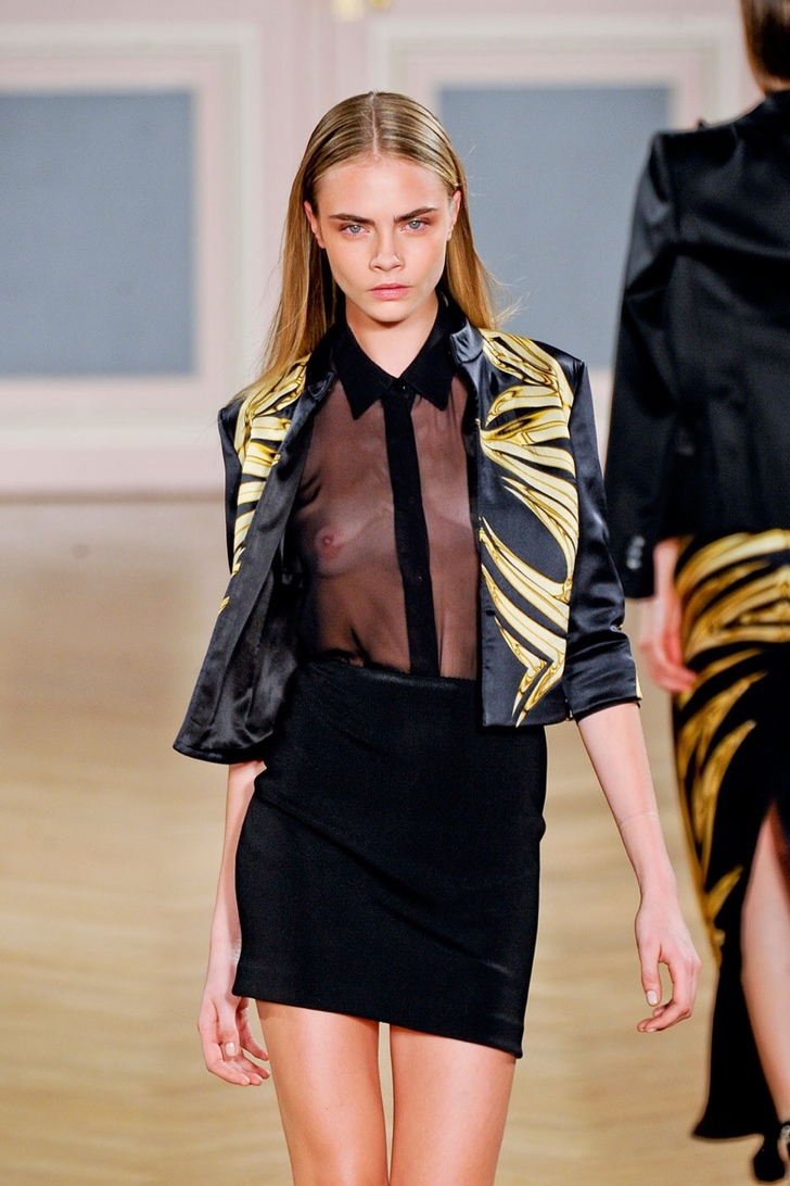 cara-delevingne-wearing-a-seethru-shirt-on-the-runway_002